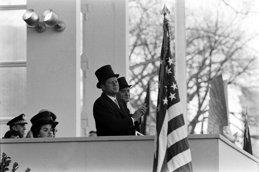 John Kennedy is seen wearing a top hat and overcoat during his inauguartion.