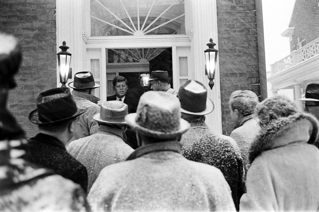 John Kennedy speaks to the press during a snowstorm the day before his inauguration.