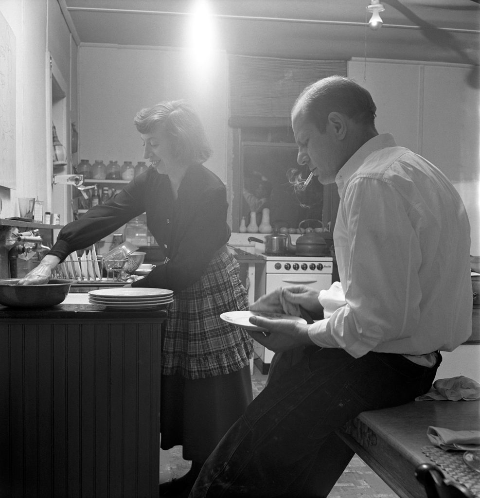 Jackson Pollock dries dishes with Lee Krasner in the kitchen of their farmhouse, 1949.