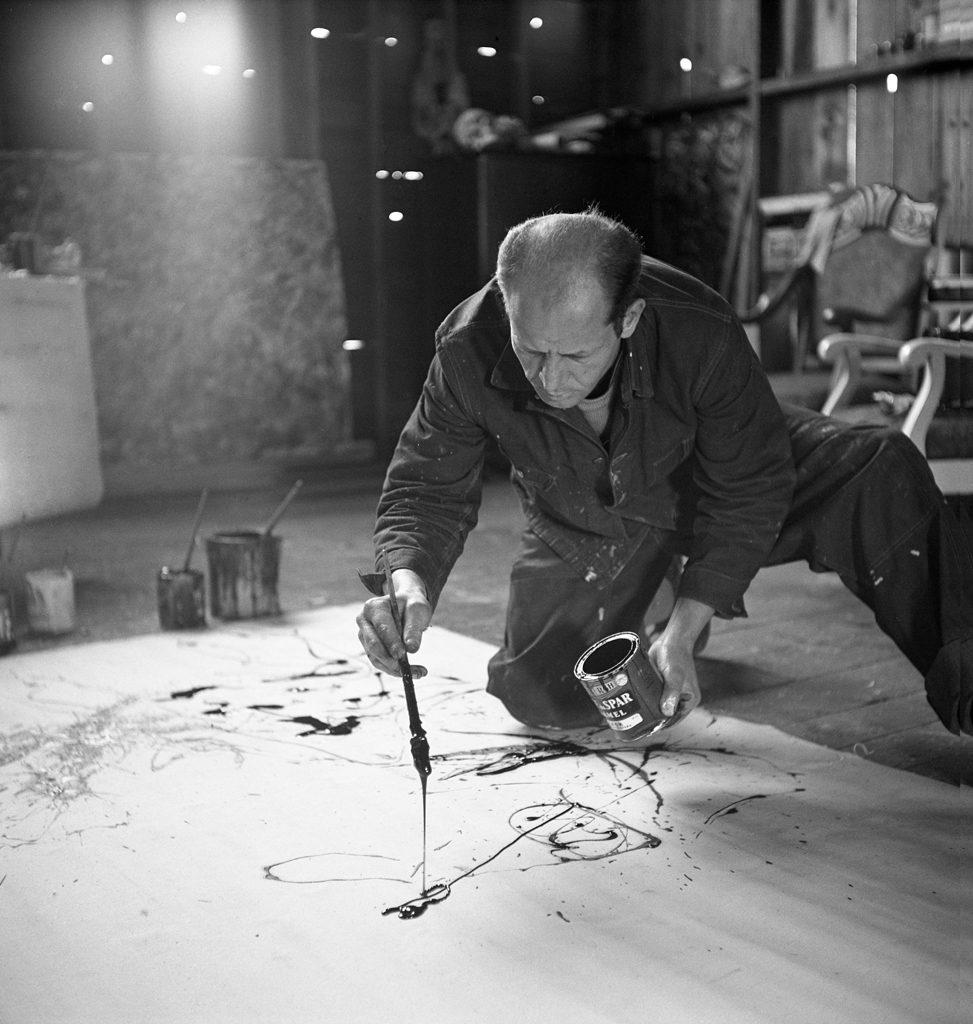 Jackson Pollock works in his Long Island studio, 1949.
