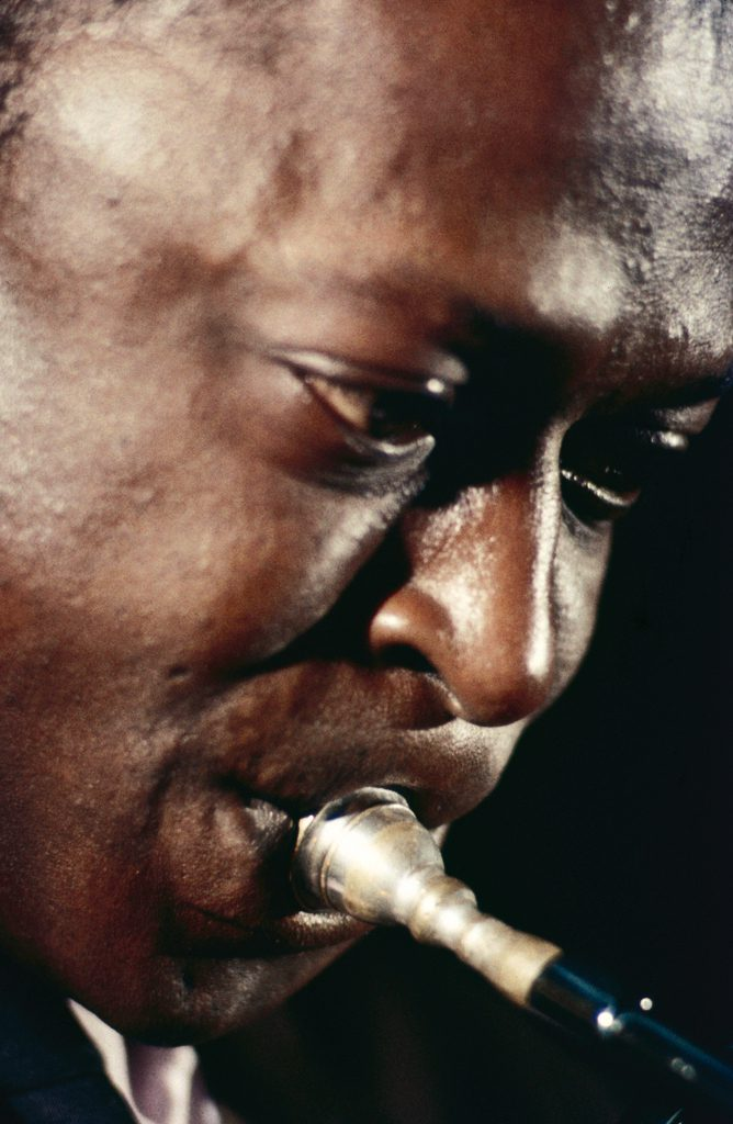 Picture of Miles Davis, close-up, in color, 1958.