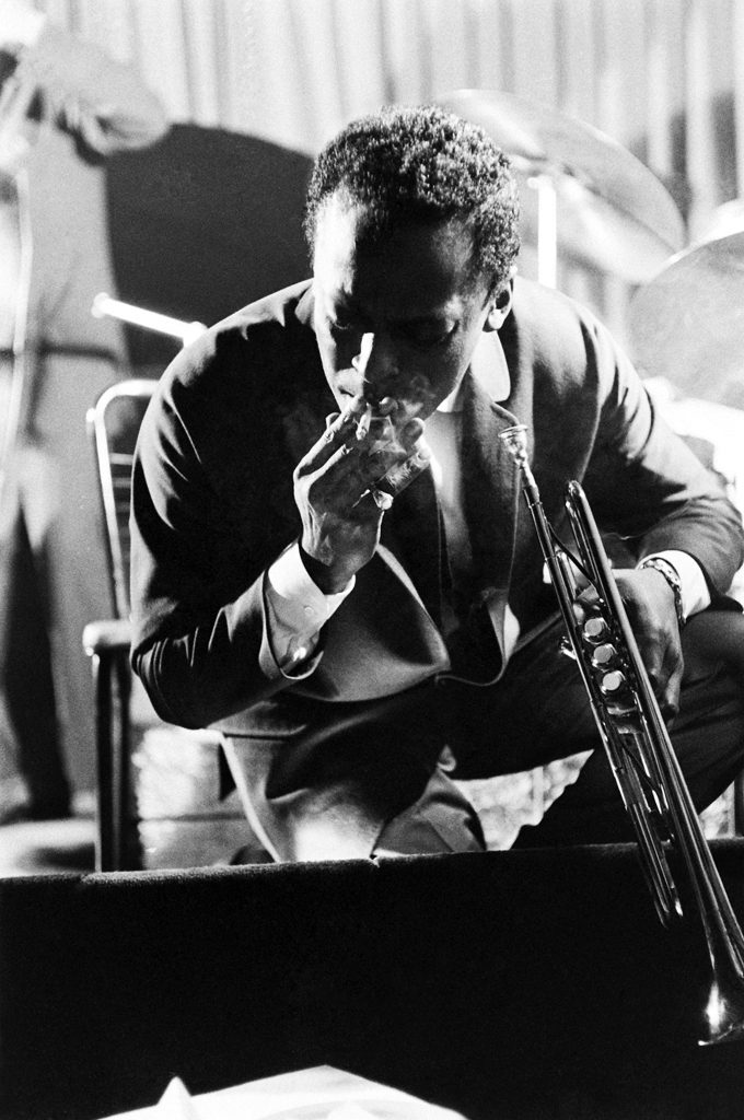 Miles Davis takes a break from performing at a club in New York, 1958.