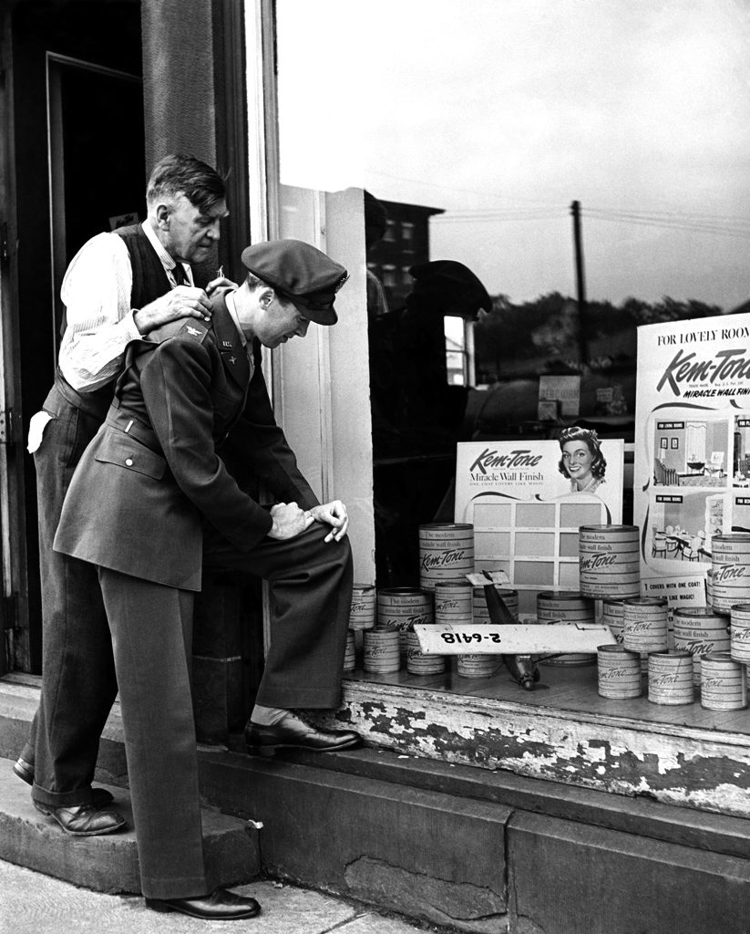 James Stewart looks in his family's hardware store window and spots a model plane he'd built years earlier, 1945.