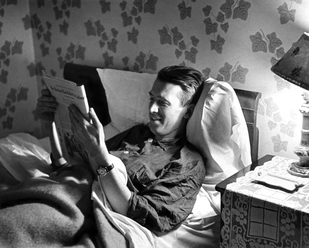 James Stewart, back home after serving in World War II, reads in bed at his parents' house, Indiana, Pa., 1945.