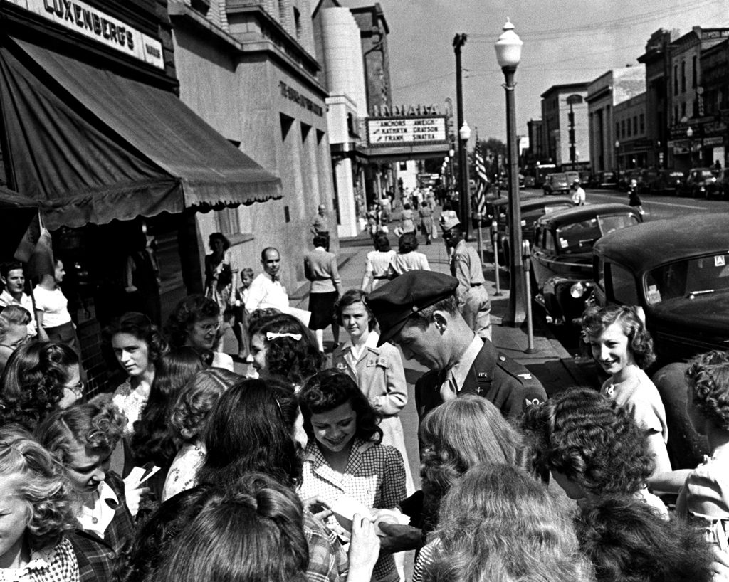 The movie star and war vet Jimmy Stewart signs autographs for local girls, Indiana, Pa., 1945.