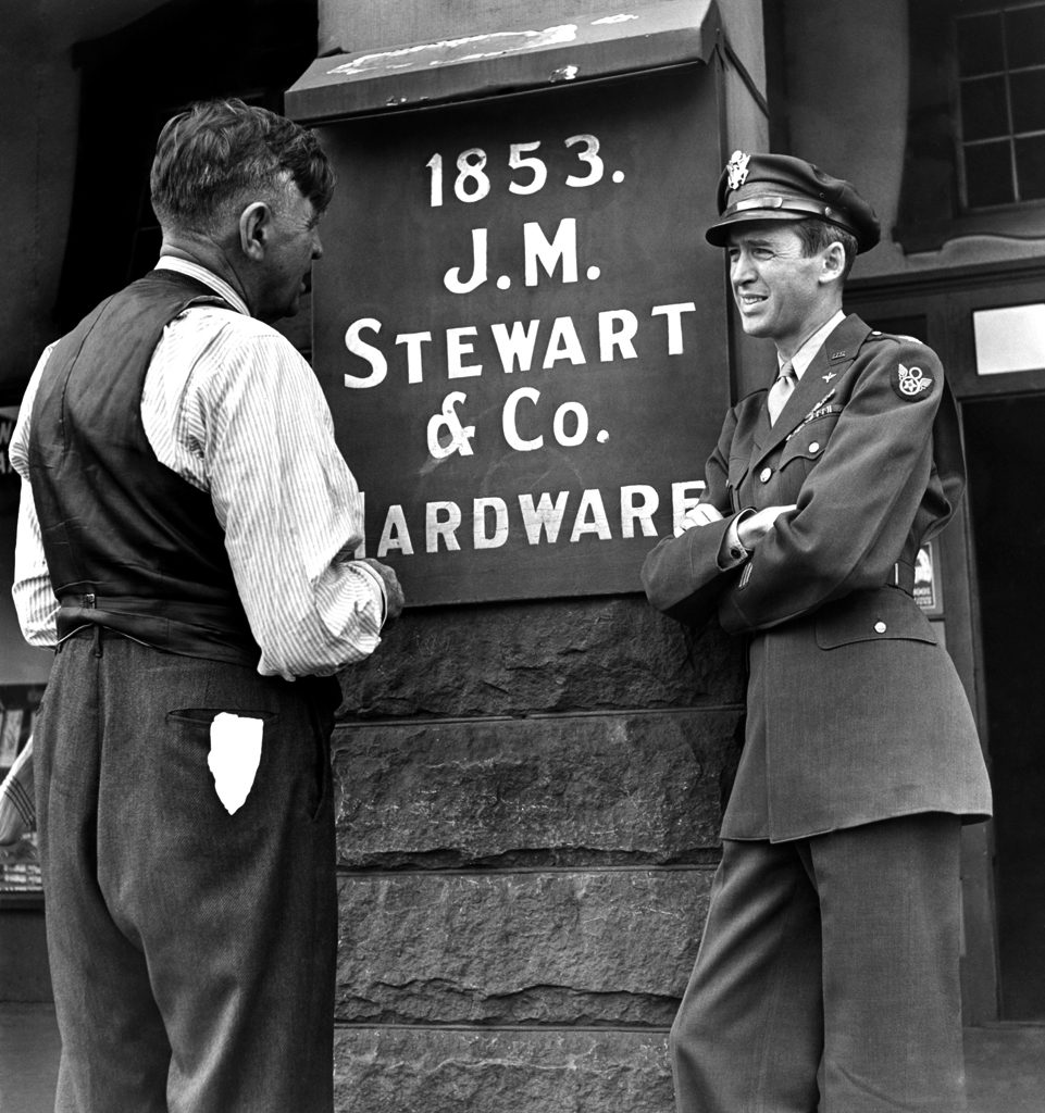 Jimmy Stewart and his dad outside the family hardware store, Indiana, Pa., 1945.