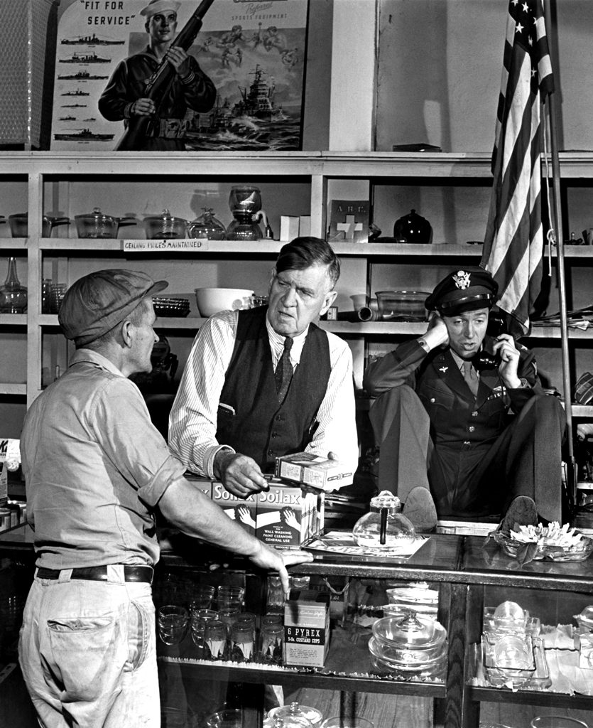 Jimmy Stewart on the phone at his father's hardware store, 1945.