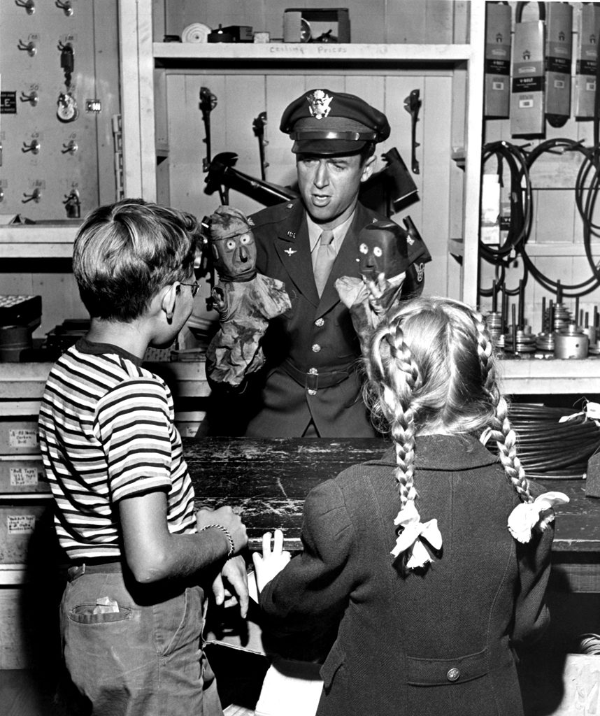 Jimmy Stewart entertains some local children, Indiana, Pa., 1945.