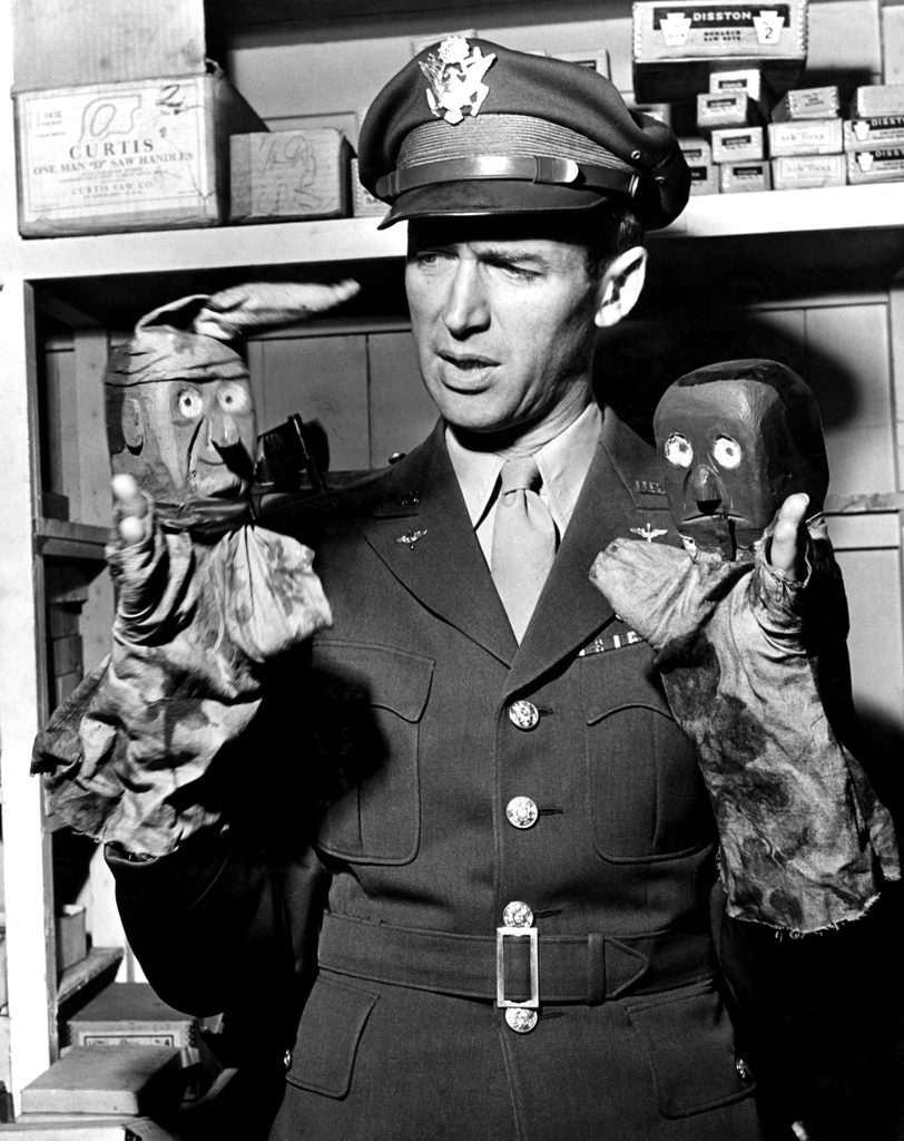 Jimmy Stewart and hand puppets, 1945