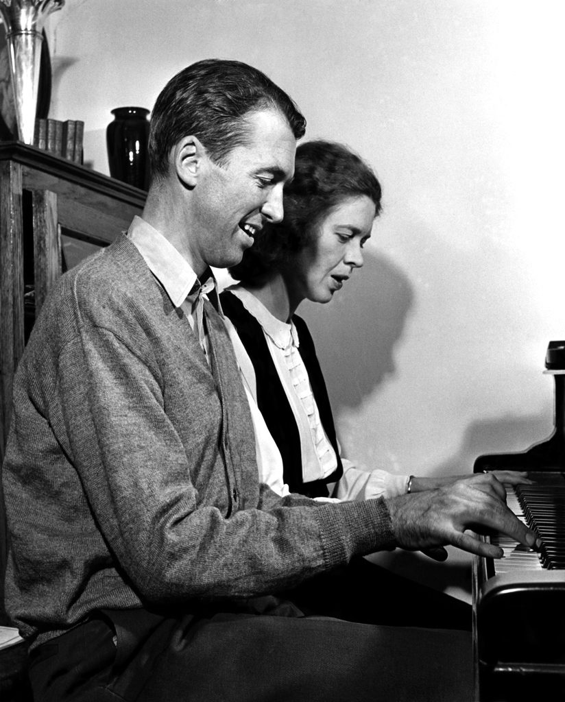Jimmy Stewart plays the piano with his sister, 1945