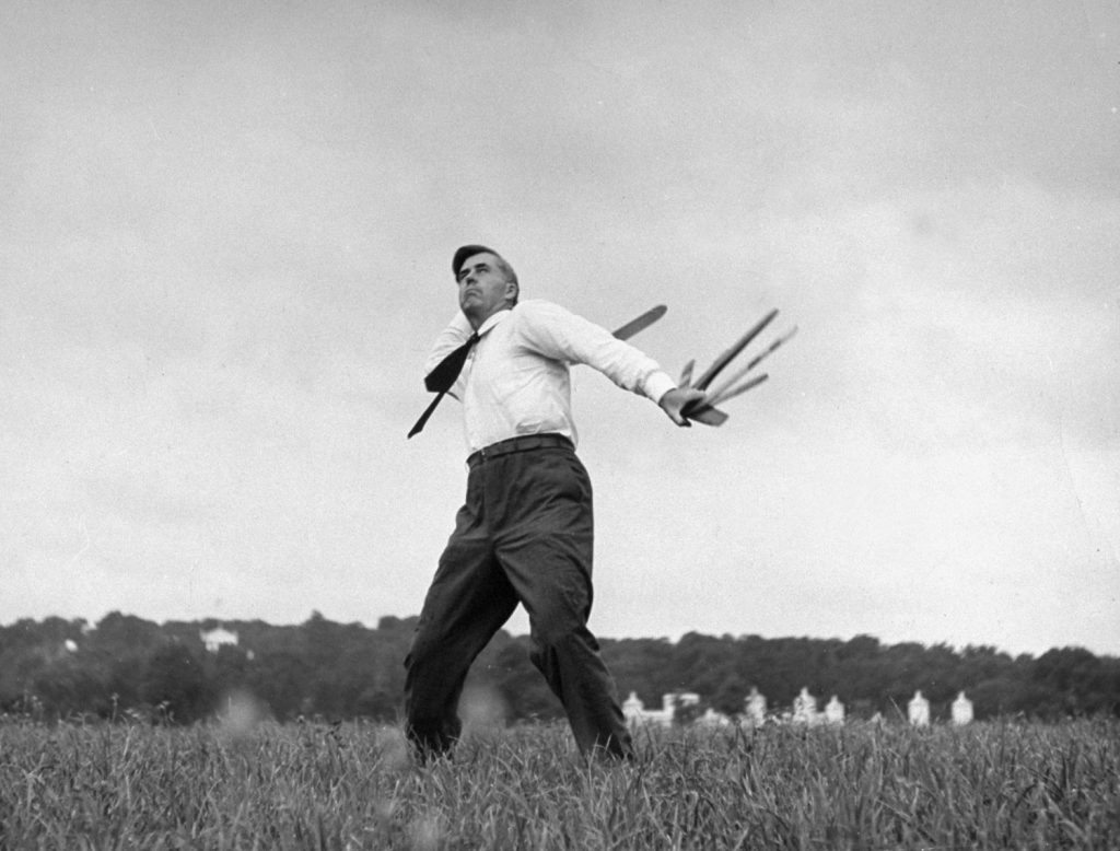 Vice Presidential candidate Henry A. Wallace throws a boomerang in a field in January 1940.