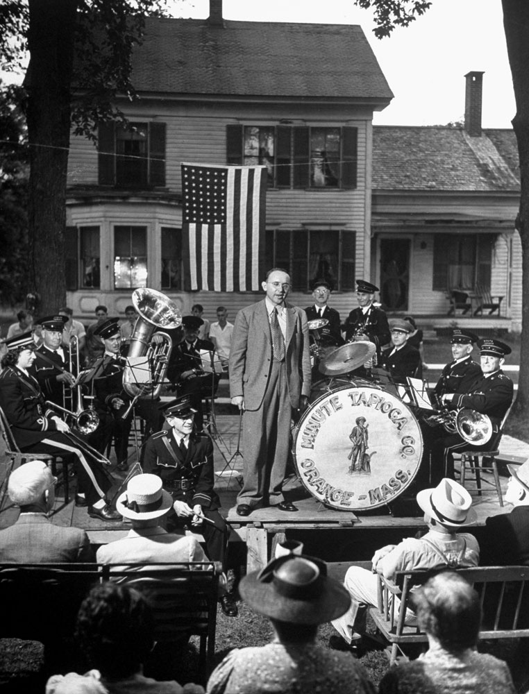 Republican candidate for Congress Raymond Leslie Buell gives a campaign speech on a platform surrounded by townspeople in a small Massachusetts park in August 1942.