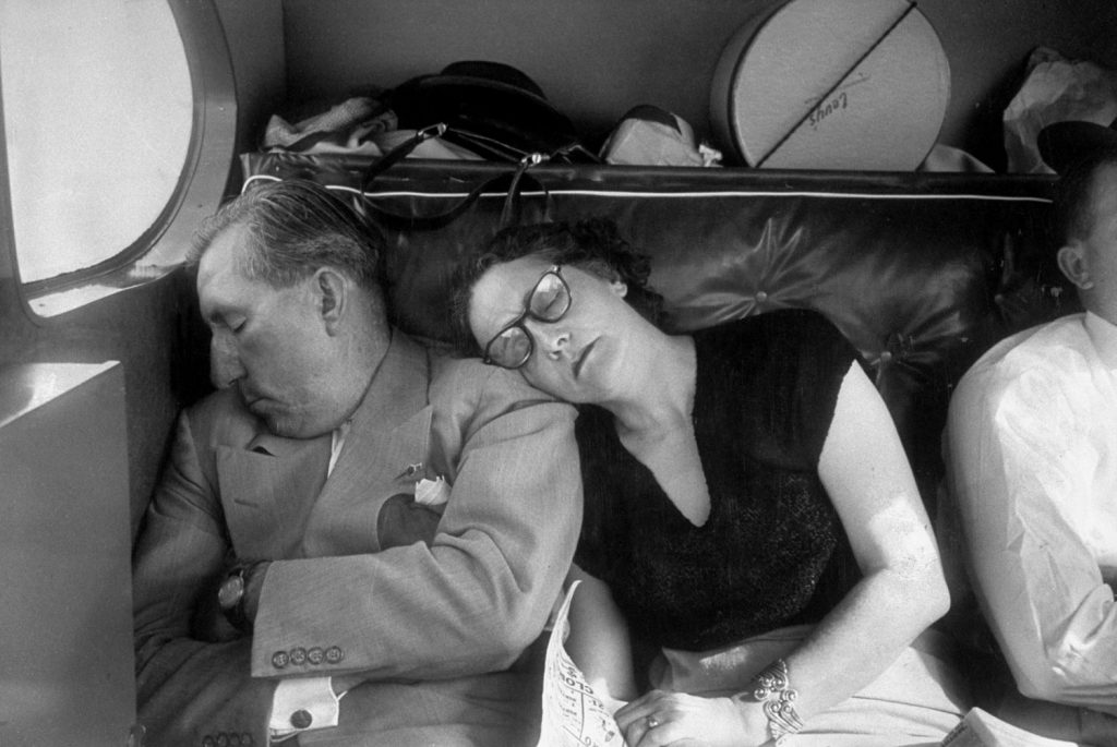 Claude D. Pepper naps with his wife in the back seat of a chartered plane as they fly home after his last campaign speech in May 1950.