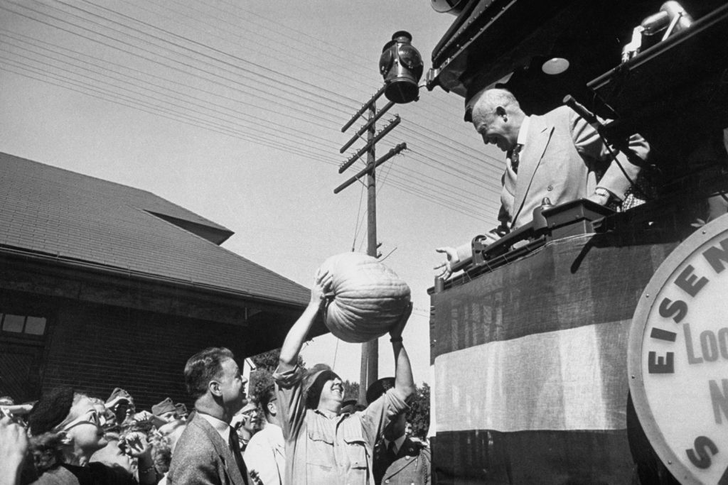 General Dwight D. Eisenhower accepts a pumpkin in 1952.