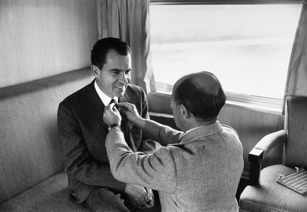 LIFE photographer Alfred Eisenstaedt adjusts Richard Nixon's tie prior to photo shoot during the 1960 presidential campaign.