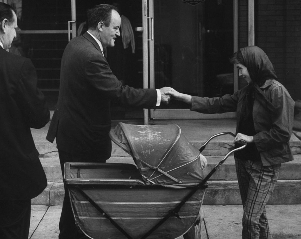 Hubert Humphrey shakes hands with a voter while campaigning prior to the West Virginia primary in April 1960.