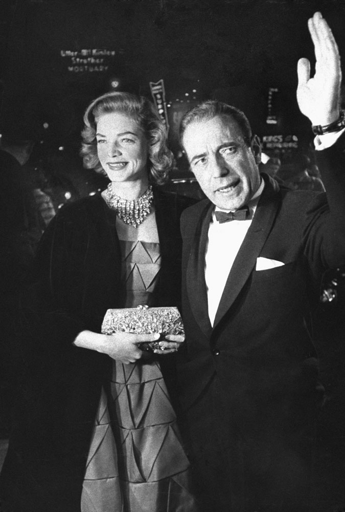 Humphrey Bogart and his wife Lauren Bacall arrive at the 27th annual Academy Awards at the RKO Pantages Theater in 1955.