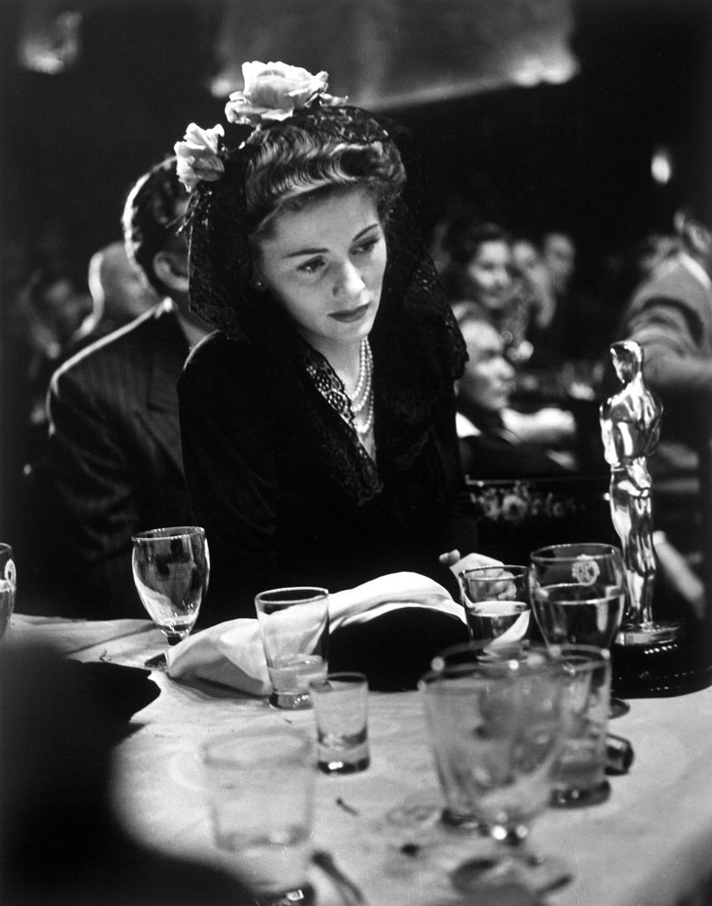 At the 1942 Academy Awards, Joan Fontaine gazes at the Best Actress Oscar she won for her role in Suspicion -- an achievement that made her, incredibly, the only actor or actress to ever win an Oscar for a performance in an Alfred Hitchcock film.