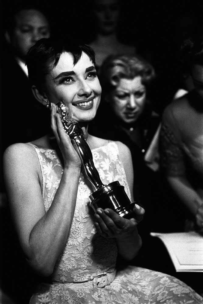 The one and only Audrey Hepburn cradles the Oscar she won for her role in Roman Holiday.