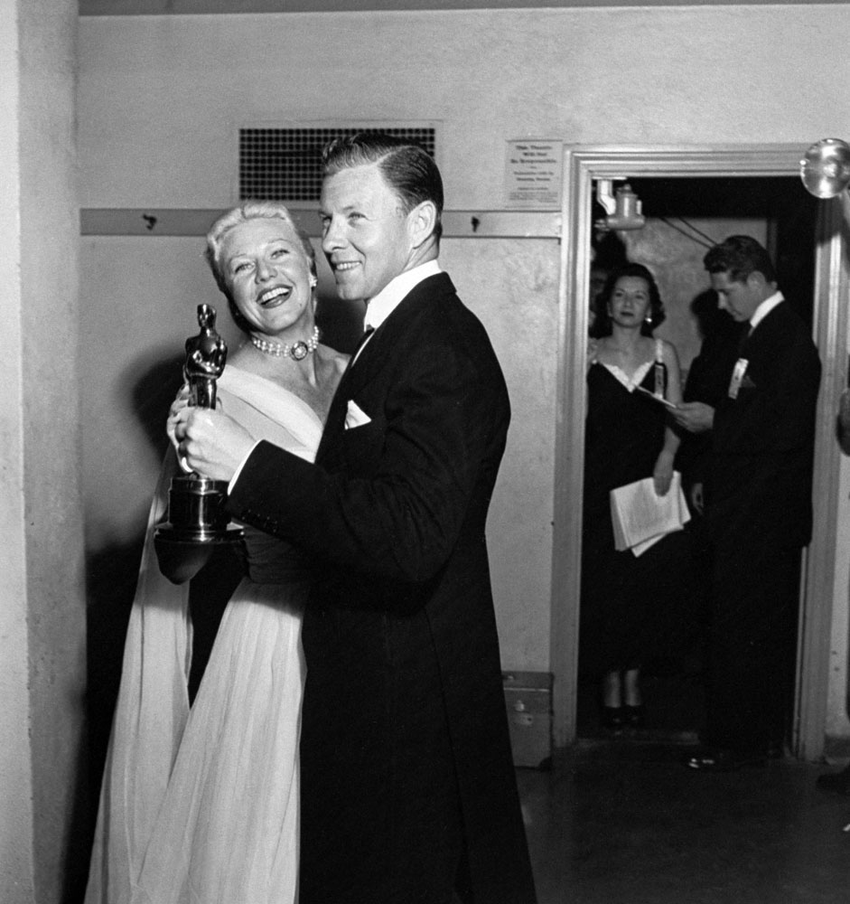 Presenters Ginger Rogers and George Murphy dance together while holding an Oscar backstage at the RKO Pantages Theatre in 1950.