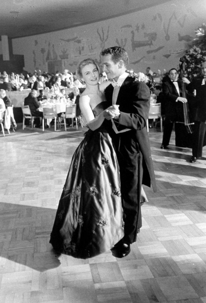 Joanne Woodward dances with her husband, Paul Newman, at the Governor's Ball following the Academy Awards where she won the Oscar for Best Actress in Three Faces of Eve