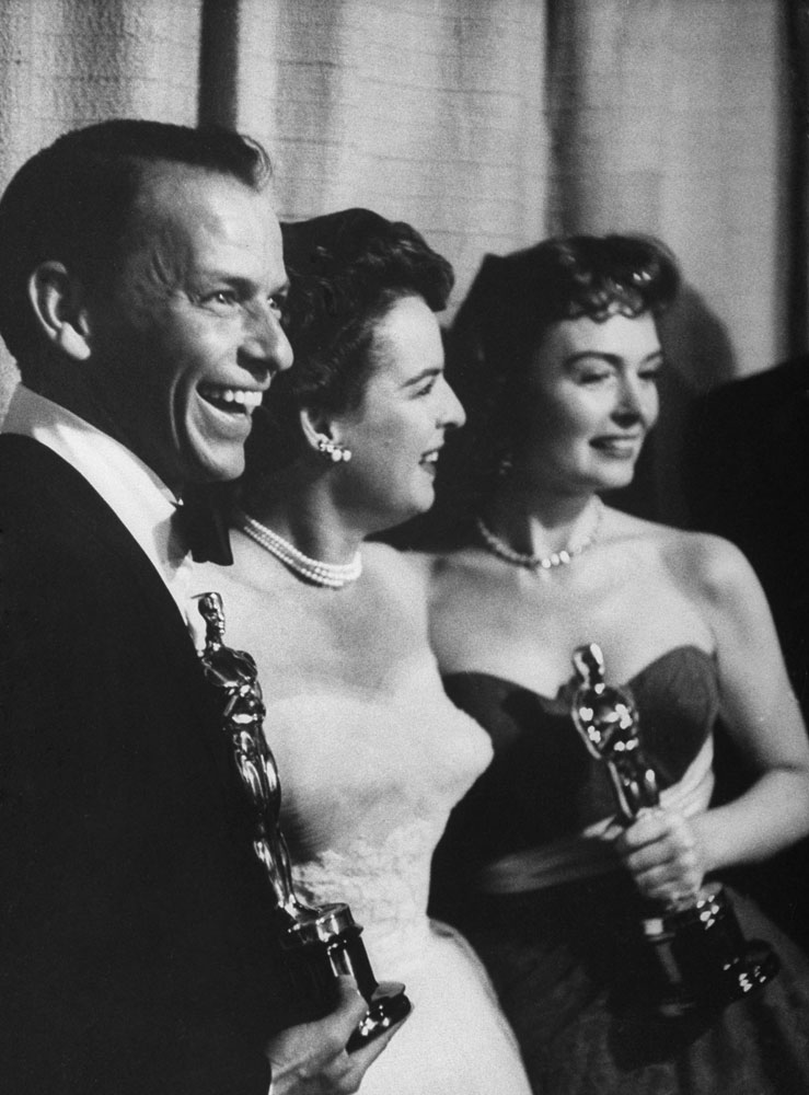 Frank Sinatra and Donna Reed hold their Oscars as Best Supporting Actor and Actress in From Here to Eternity   a film that won eight statuettes in 1954, including Best Picture.