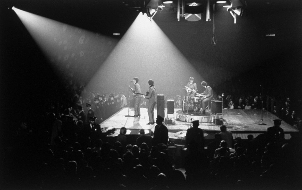 """Two days after their U.S. TV debut on """"The Ed Sullivan Show,"""" the Beatles play for 8,000 fans at their first American concert, at the Coliseum in Washington, D.C., on February 11, 1964. Ticket price: $3."""