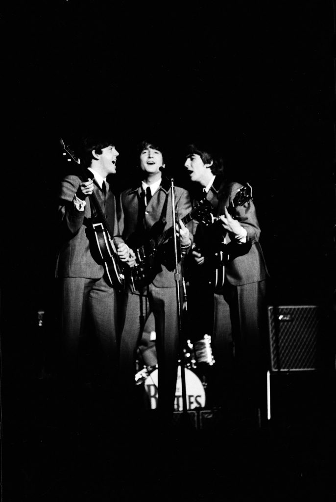 Beatles concerts, like this American show in 1964, are noisy affairs where screaming crowds drown out the band.