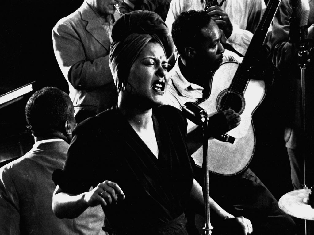 "Billie Holiday sings her standard, ""Fine and Mellow,"" accompanied by James P. Johnson on piano and others, New York, 1943."