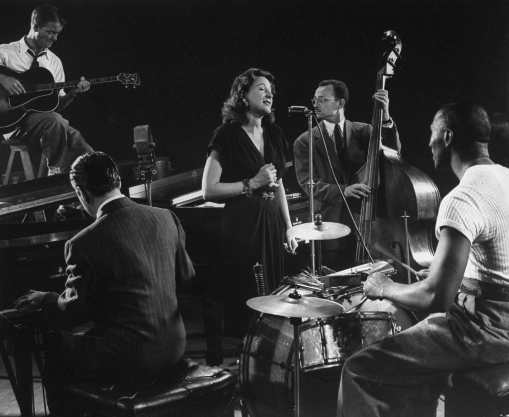 Vocalist Lee Wiley sings, accompanied by her husband, pianist Jess Stacy, with Eddie Condon on guitar, Sid Weiss on bass and the great Cozy Cole on drums, 1943.