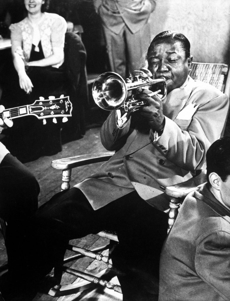 The one and only Roy Eldridge plays trumpet during drummer Gene Krupa's jam session at Gjon Mili's studio, 1940s.