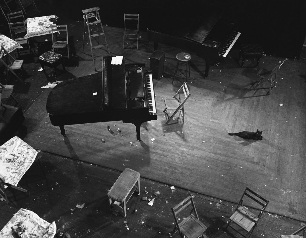 The next morning, Gjon Mili's studio was littered with cigaret stubs, broken glasses, spilled liquor. Many jazz musicians eat scrambled eggs and benzedrine for breakfast.