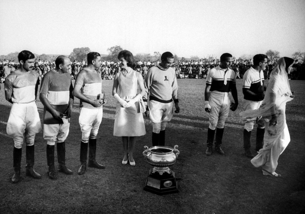 Jackie Kennedy presents a cup to Princess Gayatri Devi, right, and members of a polo team in Jaipur in March 1962.