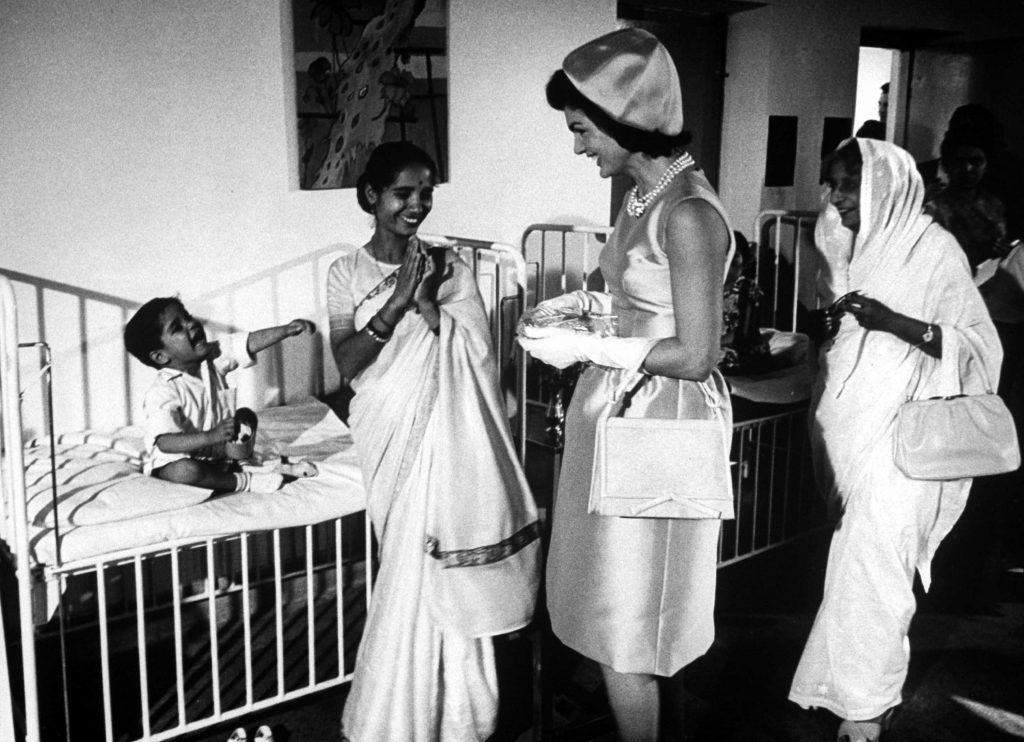 Jackie Kennedy visits children in a hospital during her tour of India in March 1962.