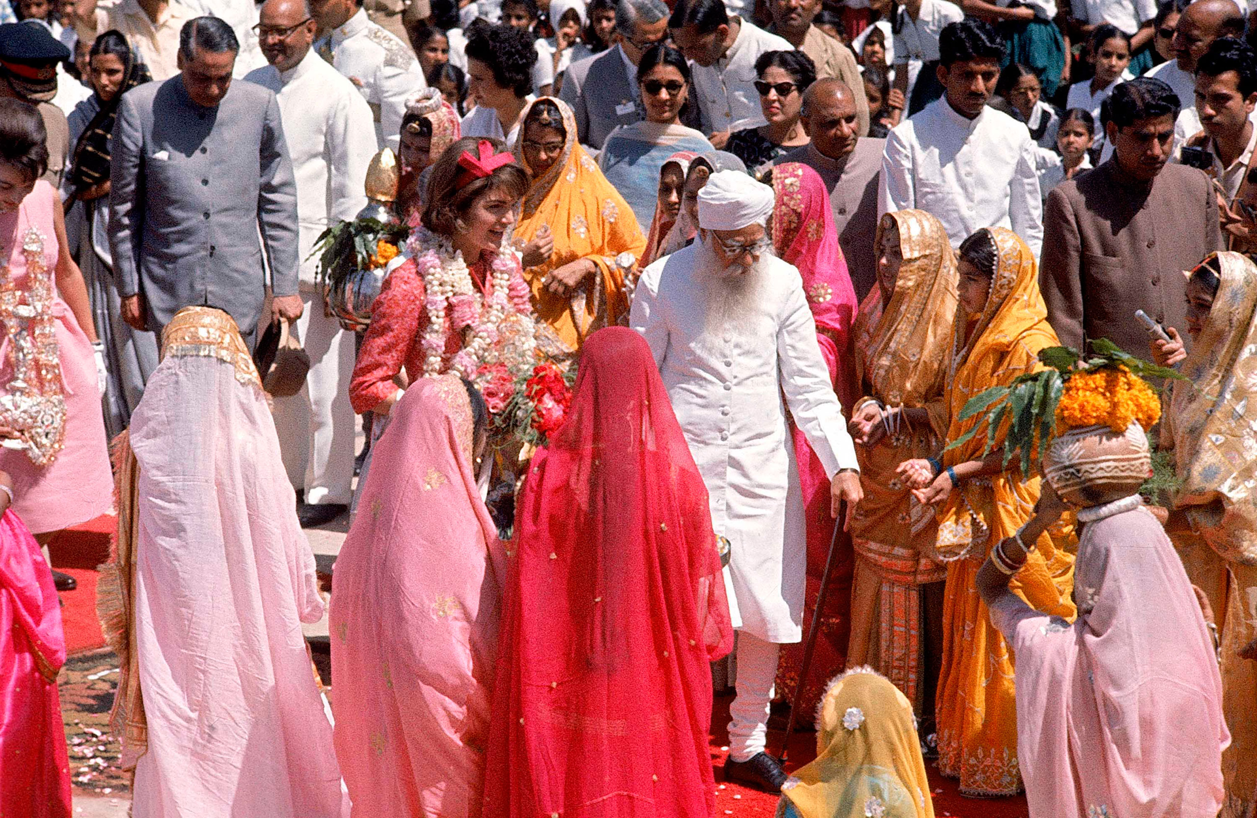 First Lady Jackie Kennedy is greeted by Gov. Gurmukh Nihal Singh, center, at Jaipur Airport in March 1962.