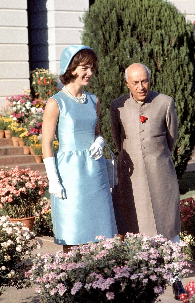 Jackie walks with Indian Prime Minister Jawaharlal Nehru in the garden of his home in 1962.
