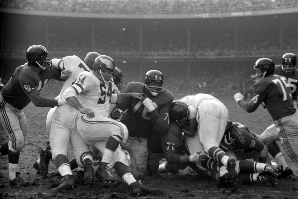Rosey Grier (#76) finds himself in a familiar spot -- in the middle of the action during a 1960 game against New York's perennial rivals, the Eagles.