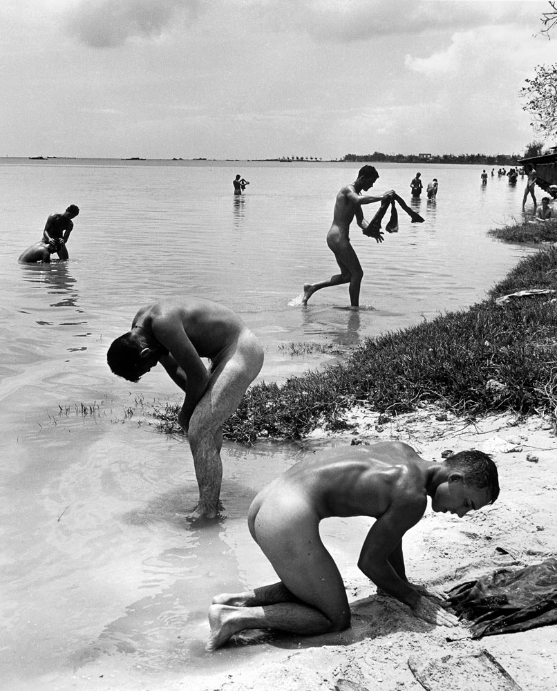 American troops in the Pacific bathe during a lull in the fighting on the island of Saipan, 1944.