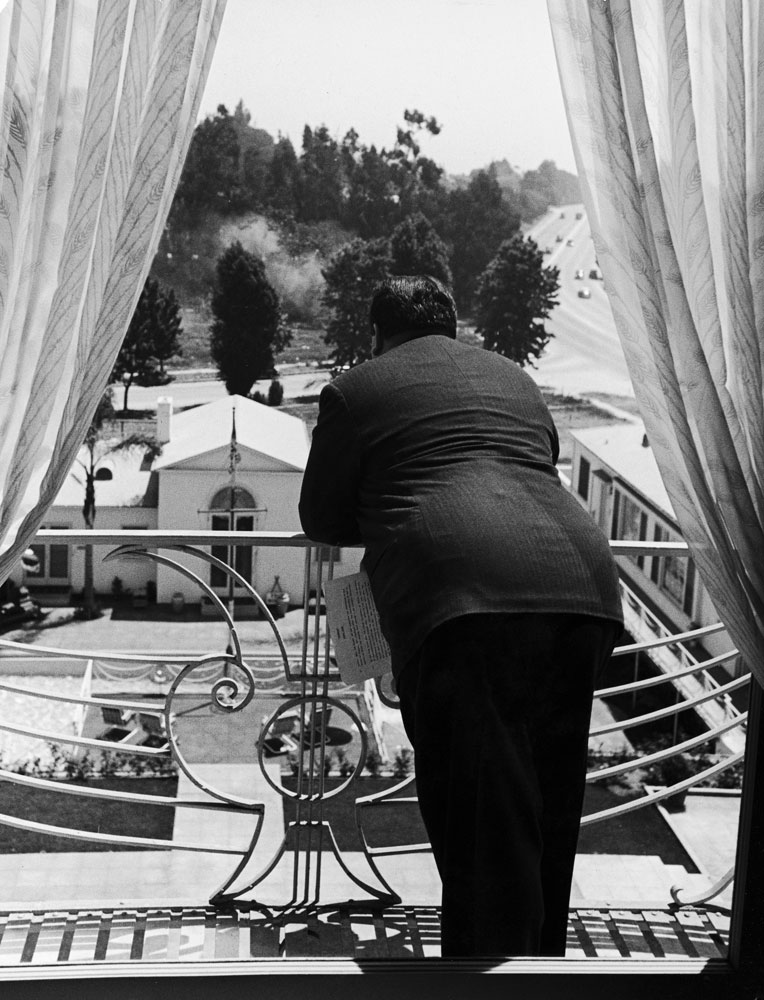 Alfred Hitchcock looks out over the grounds of the Beverly-Wilshire Hotel in 1939.