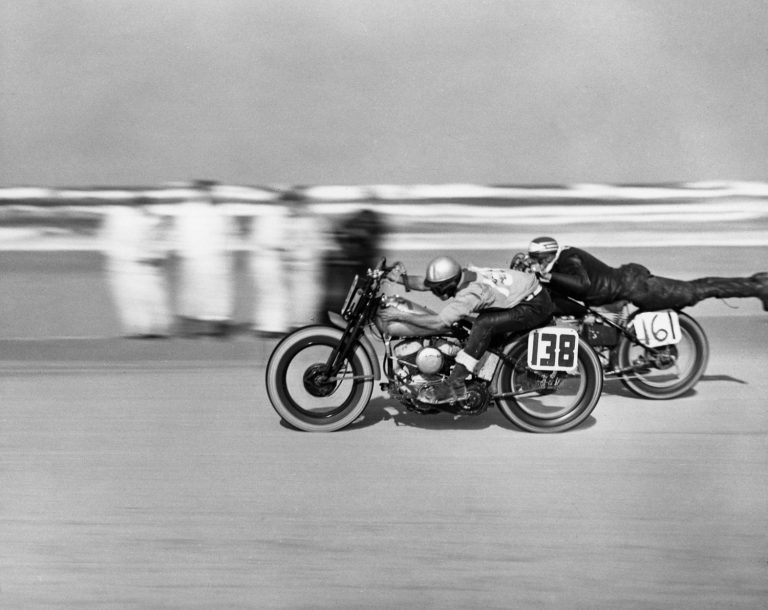Number 161 Norman Teleford streamlines himself during a motorcycle race at Daytona Beach, March 1948.
