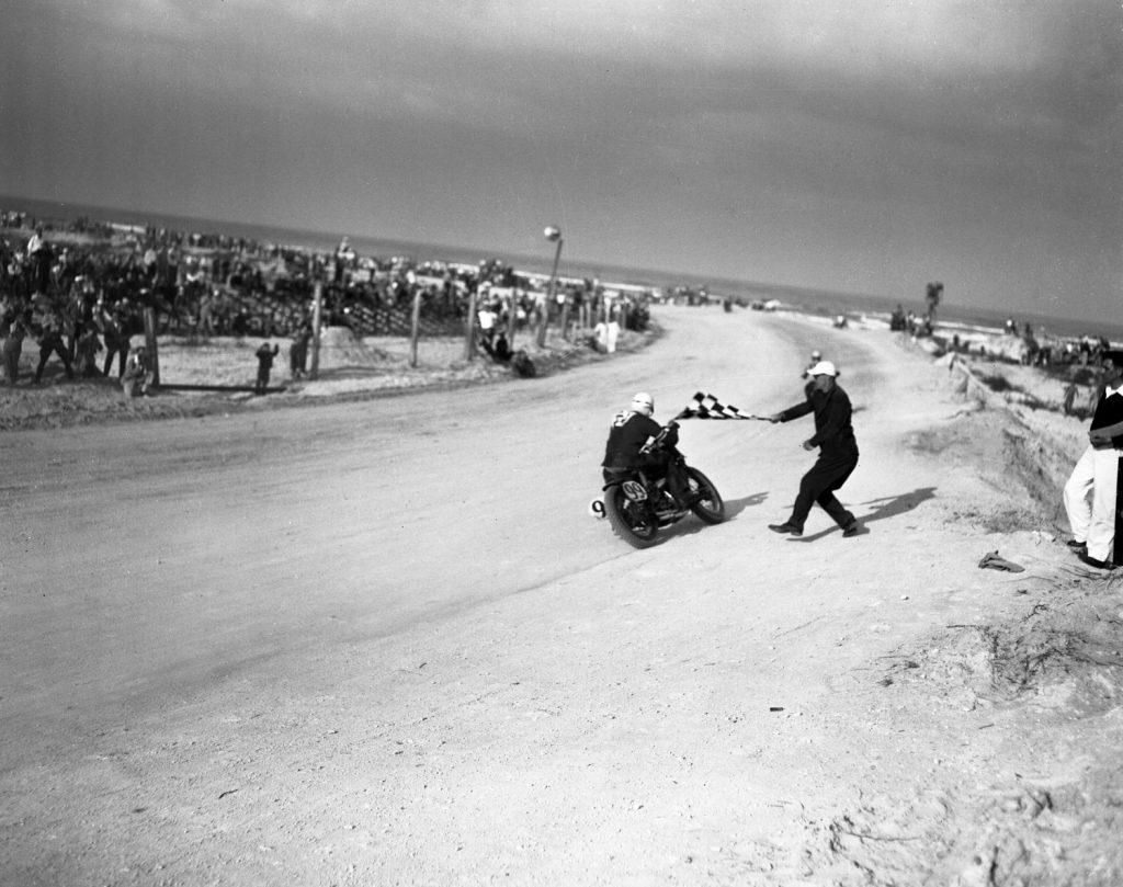 The checkered flag waves as Floyd Emde wins the 1948 Daytona 200.