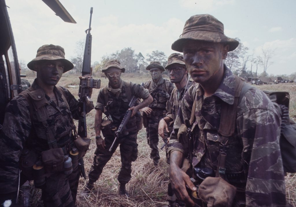 American soldiers of 2nd Battalion, 503rd Airborne Infantry, 173rd Airborne Division gear up for a long range patrol during Operation Junction City, a massive 1967 search and destroy operation in Vietnam.