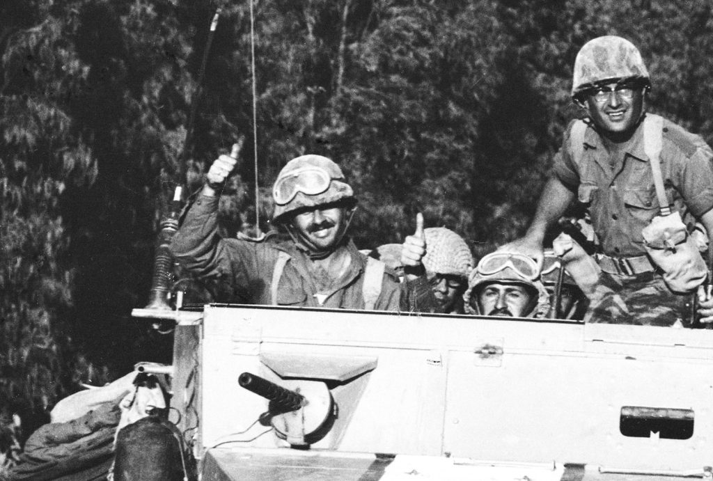 Israeli soldiers giving the thumbs up in one of the last pictures taken by photographer Paul Schutzer before he was killed during the Six-Day War in 1967.