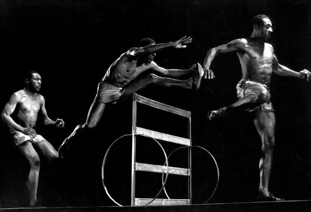 United States pentathlon champion John Borican leaps a hurdle in 1941.