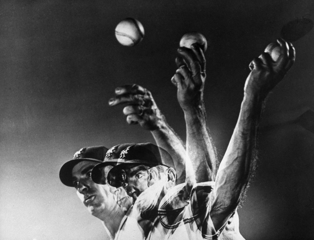 New York Giants pitcher Carl Hubbell throws a curve ball, 1940.
