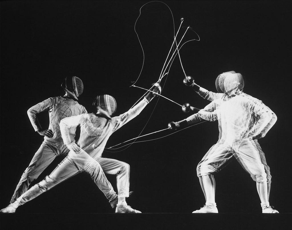 Stroboscopic image of New York University fencing champion Arthur Tauber (left) parrying with Sol Gorlin, 1942.