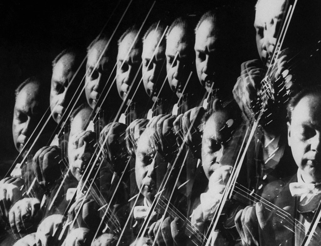Stroboscopic image showing a repetitive closeup of Isaac Stern playing violin at photographer Gjon Mili's studio in 1959.
