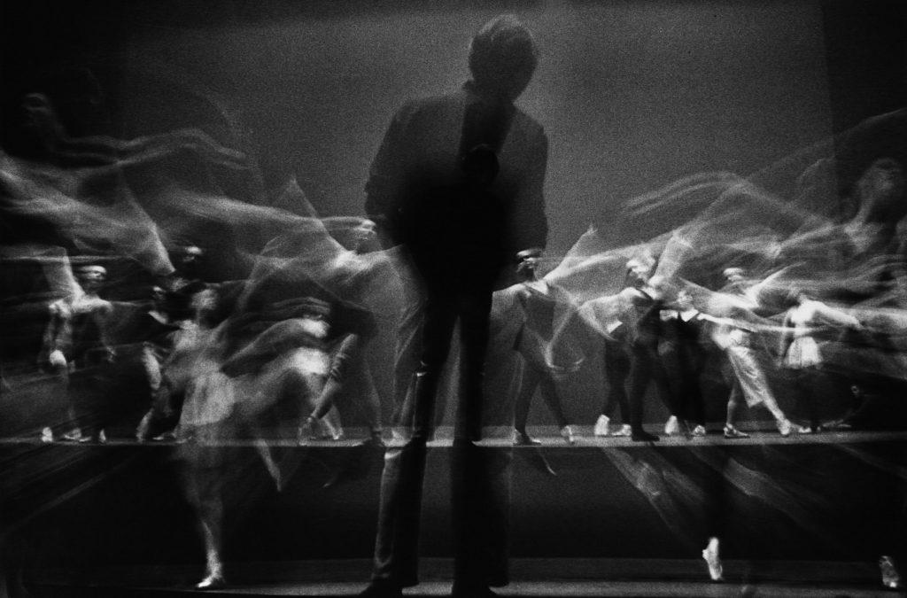 Stroboscopic image of choreographer George Balanchine watching New York City Ballet dancers rehearse in 1965.