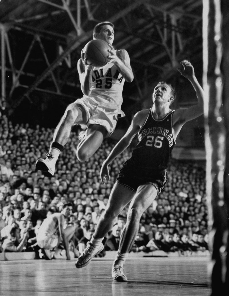 Burke Scott (above, with ball) was a starter on Indiana's 1953 NCAA championship team, the second of Indiana's five title winners.