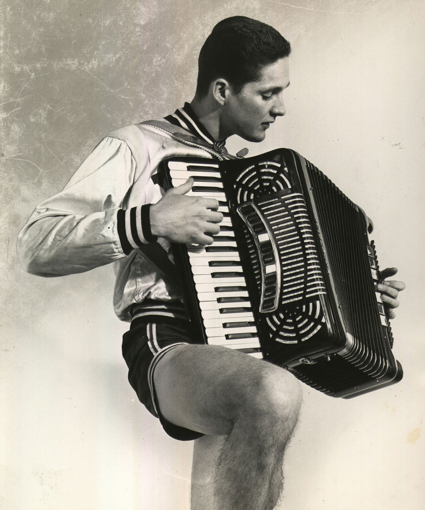 Yale basketball star Tony Lavelli playing the accordion